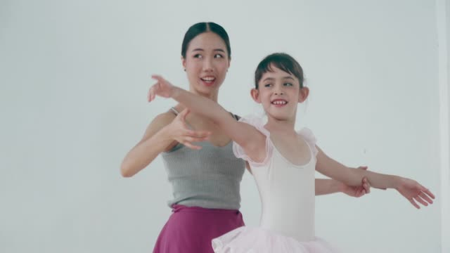 Young ballet dancer practicing ballet with her coach video