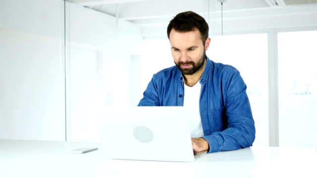 Young Beard Man working on Laptop in Office video
