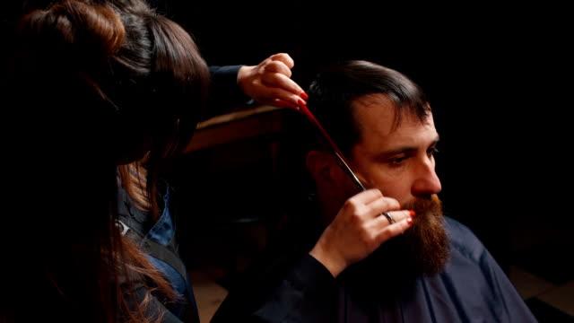 young bearded man cut in barbershop video