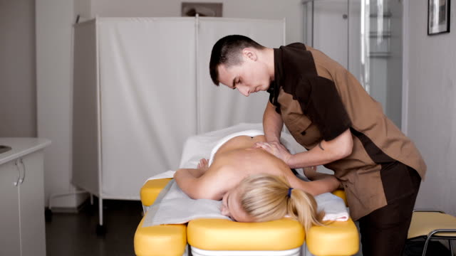 Young, beautiful and healthy woman getting alternative massage treatment video