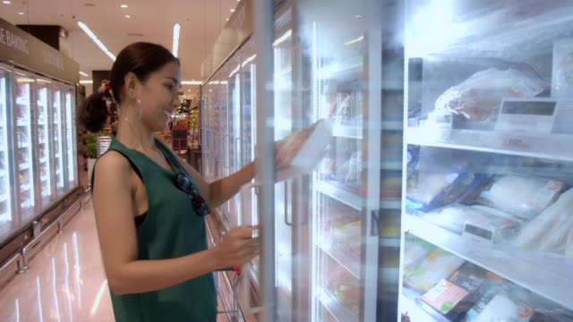 young beautiful asian woman buying fresh frozen seafood at the grocery store supermarket. - body conscious stock videos & royalty-free footage