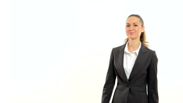 Young beautiful business woman showing okay