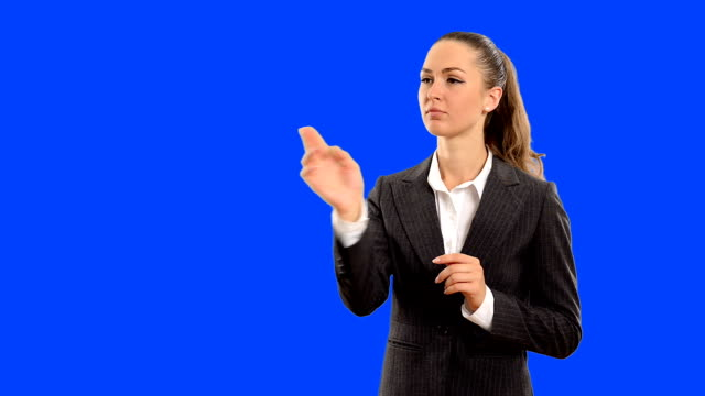 Young beautiful business woman touches the invisible blue and and thinks about the right solution . Close-up video