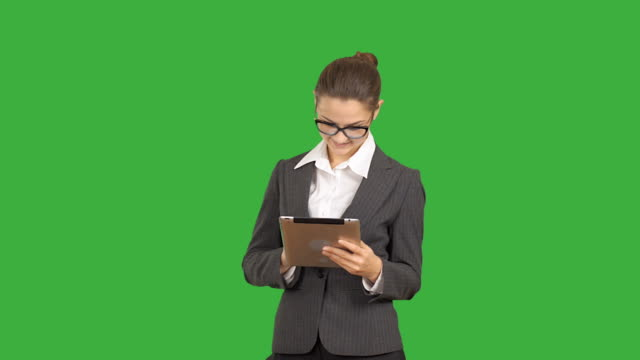 stockvideo's en b-roll-footage met young beautiful business woman working on the tablet. - background baby