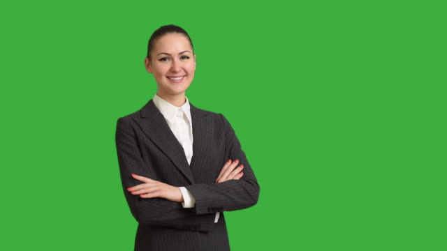 Young beautiful businesswoman crosses her arms on a white background. Close-up video