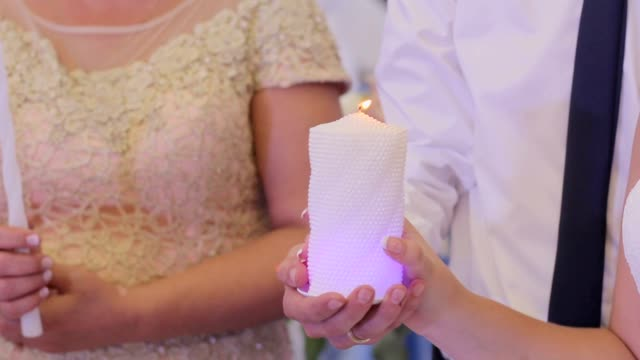 Young beautiful couple holding a burning candle video