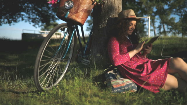 Young beautiful, elegantly dressed woman with bicycle video