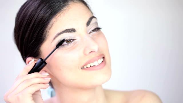 Young Beautiful Girl Applying Makeup video