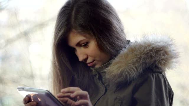 Young, beautiful girl working in his tablet computer - Stock video video