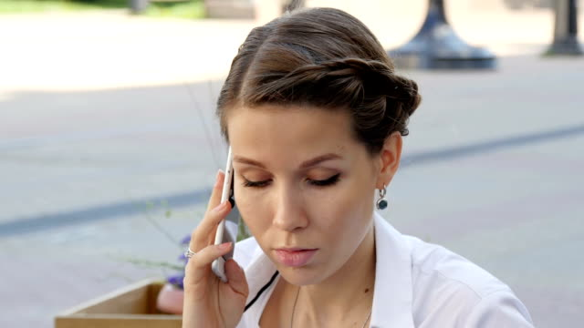 Young beautiful smiling woman talking on cell phone video