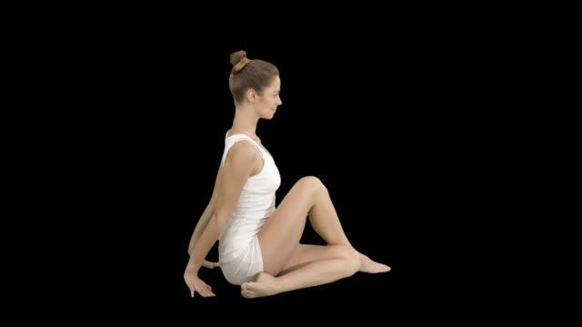 Young beautiful woman doing yoga asana Marichyasana, Alpha Channel