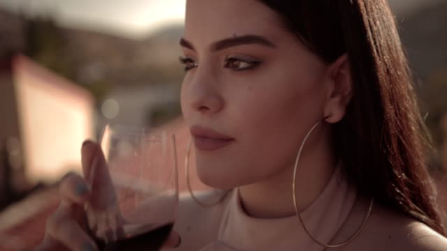 Young beautiful woman drinking red wine on countryside house patio Young beautiful woman drinking red wine at traditional mediterranean vineyard winery wine tasting red wine stock videos & royalty-free footage