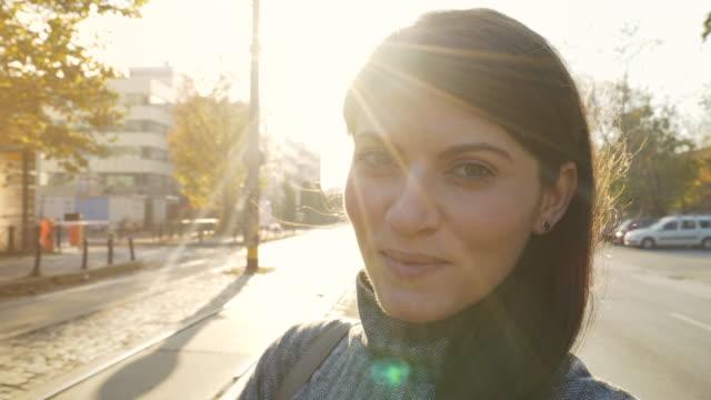 young beautiful woman outdoors. - gente serena video stock e b–roll