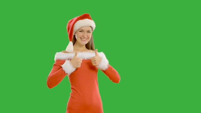 Young beautiful woman shows copy space in santa claus hat video