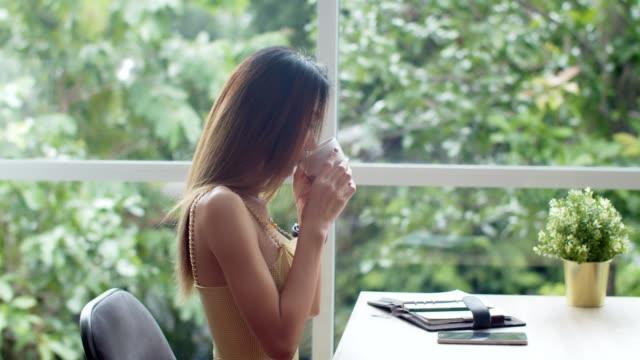 Young beautiful woman take a break at coffee shop