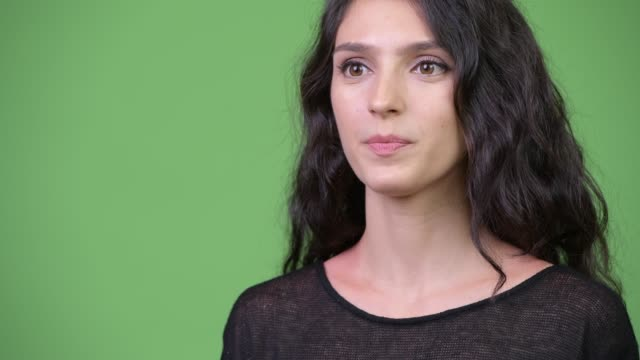Young beautiful woman talking Studio shot of young beautiful woman against chroma key with green background interview event stock videos & royalty-free footage