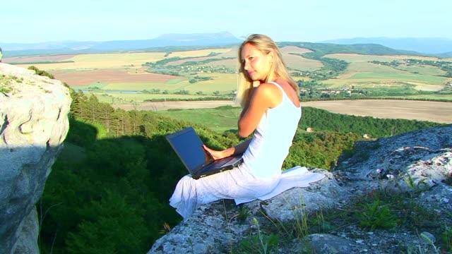 Young beautiful woman using Laptop video
