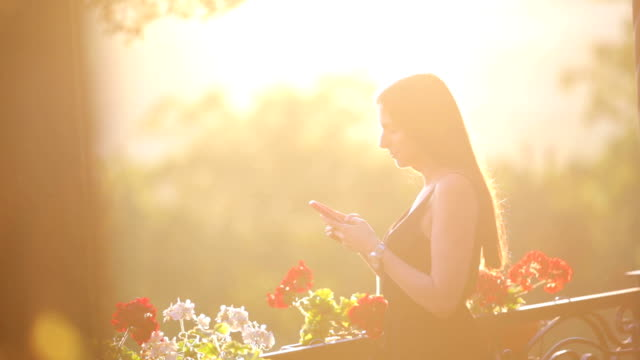 Young beautiful woman using smartphone video