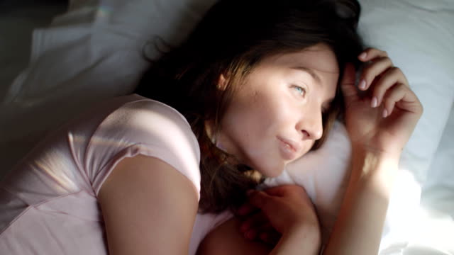 Young Beautiful Woman Wakes Up In The Morning video