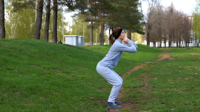 young beauty girl do exercises at the park video