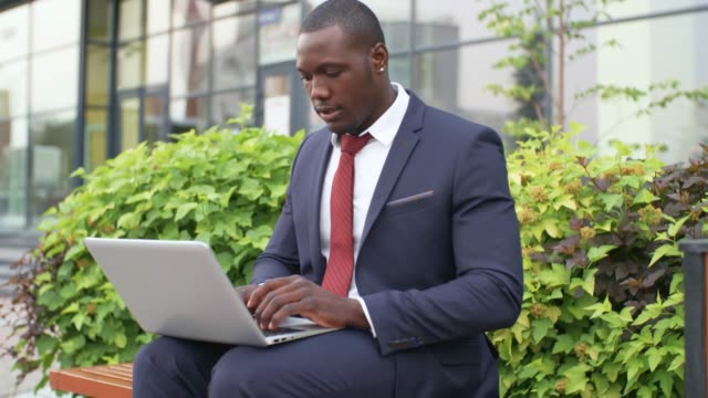 Young Black Businessman Working on Computer