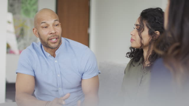 Young Black Couple Talking To Therapist