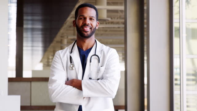Young Black male doctor wearing a lab coat video