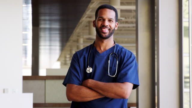 young black male doctor wearing scrubs - nurse stock videos & royalty-free footage