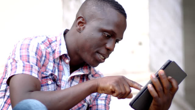 young black man using the tablet- portrait video