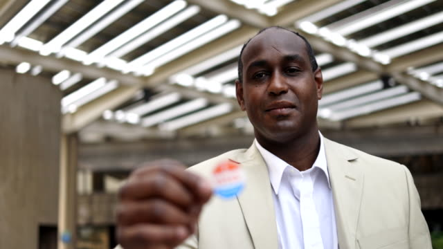 Young Black Man with I voted Sticker