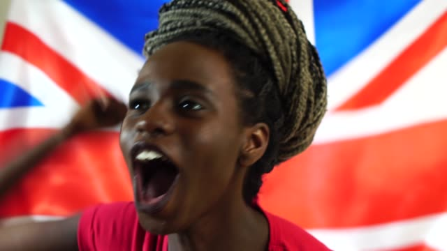 UK Young Black Woman Celebrating with UK Flag video