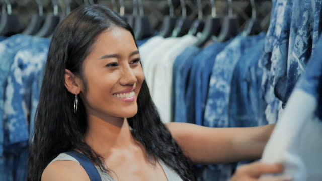 Young black woman shopping clothes in a clothing store.Shopping, People, Lifestyle, Business, Millennials Grocery Shopping concept. video