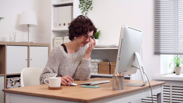 Young Blogger at Work Typing her New Post