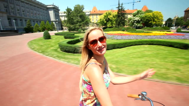 Young blond woman cycling video