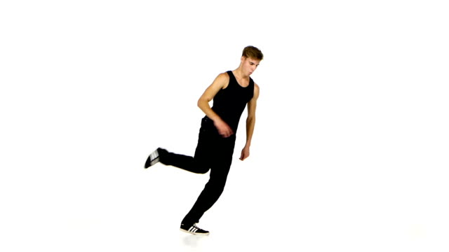 Young blonde dancer man dancing breakdance on white video