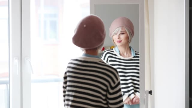 young blonde girl dressing up at home - cappello video stock e b–roll