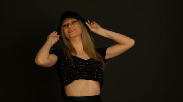 Young blonde model with hat during a shooting session video
