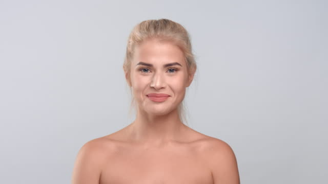 Young blonde woman looking at the camera and laughing video