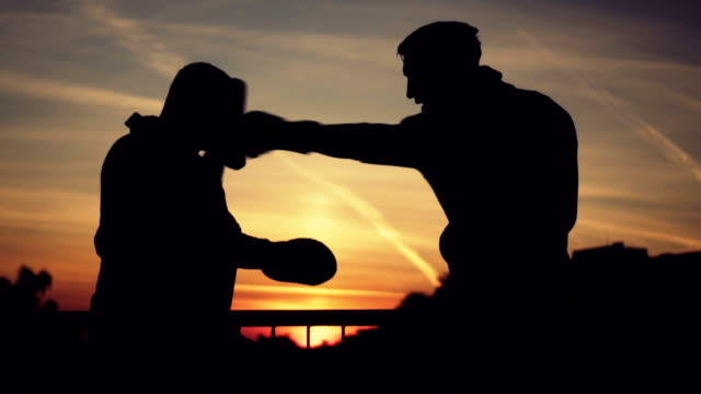 Young boxer training with his coach video
