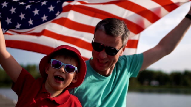Young boy and his father with the American flag video