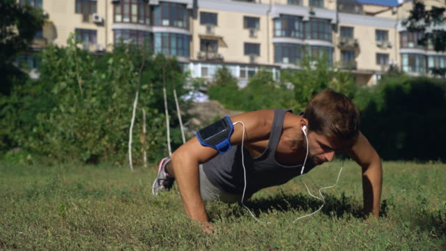 Young boy athlete squeezed in a park near the house video