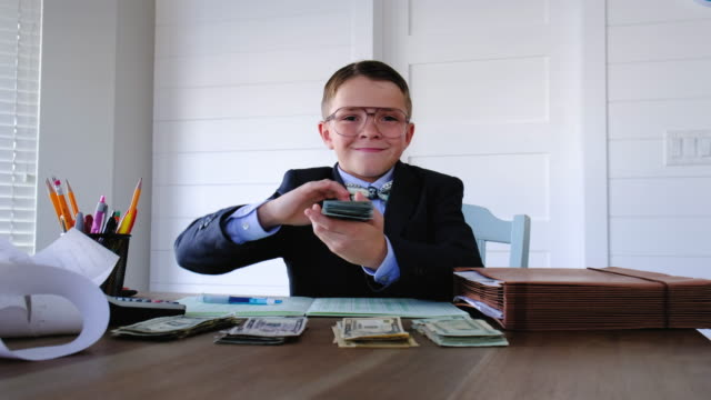Young Boy Businessman Flinging Benjamins