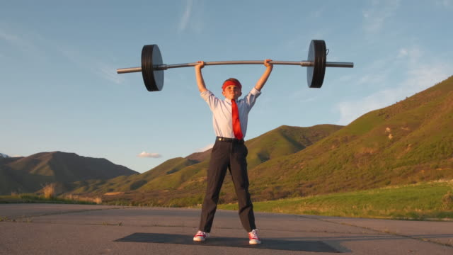 Young Boy Businessman Lifting Weights