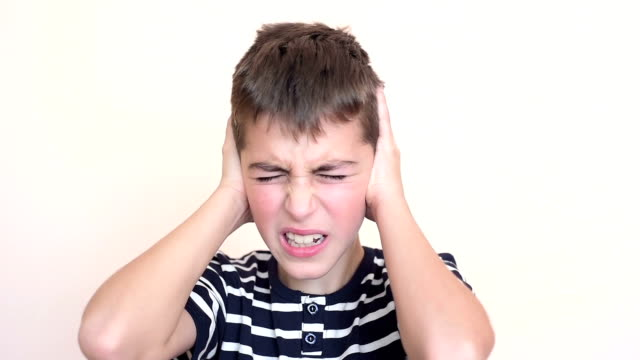 Young boy covering his ears video