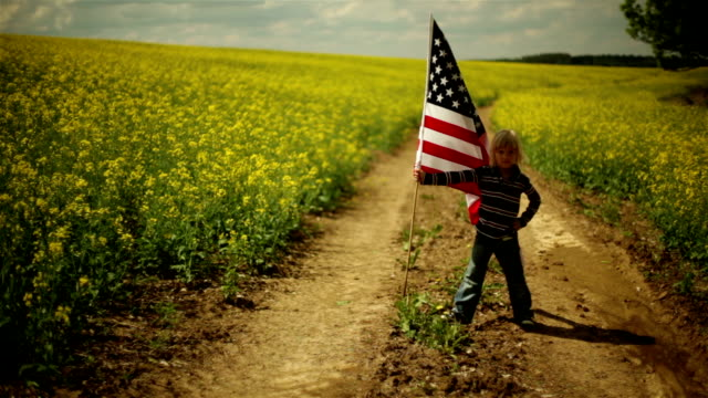 young boy displays his flag