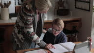 istock Young boy does schoolwork at home 1220407022