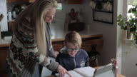 istock Young boy does schoolwork at home 1220410374