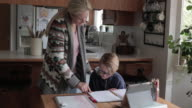 istock Young boy does schoolwork at home 1220412288