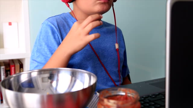 Young boy eating chips video
