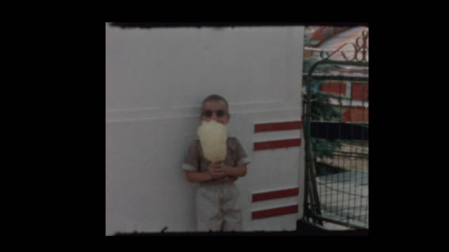 1957 Young boy eats cotton candy at carnival 1957 Young boy eats cotton candy at carnival cotton candy stock videos & royalty-free footage